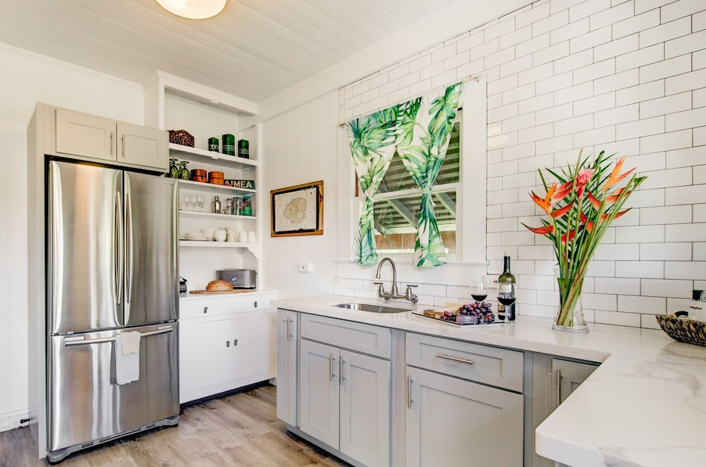 White and grey kitchen of a family rental in Waimea