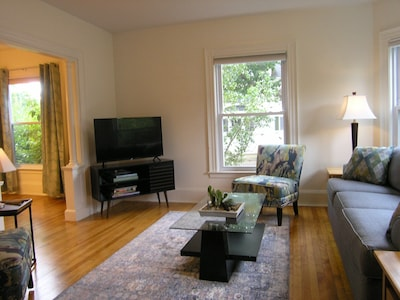 Living room with view of television and dining room