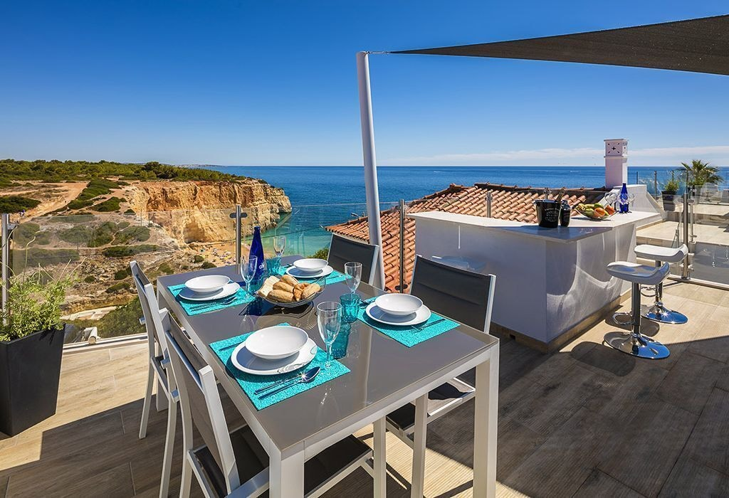 Table at a terrace overlooking Benagil