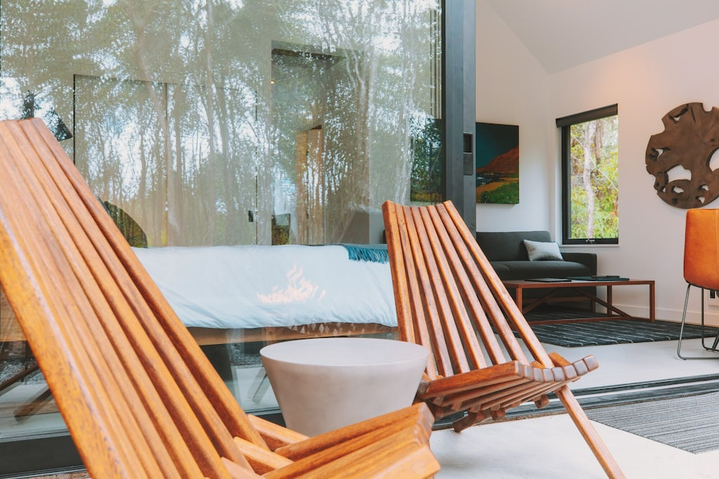 Two wooden deck chairs on the lanai of this Airbnb in Hawaii