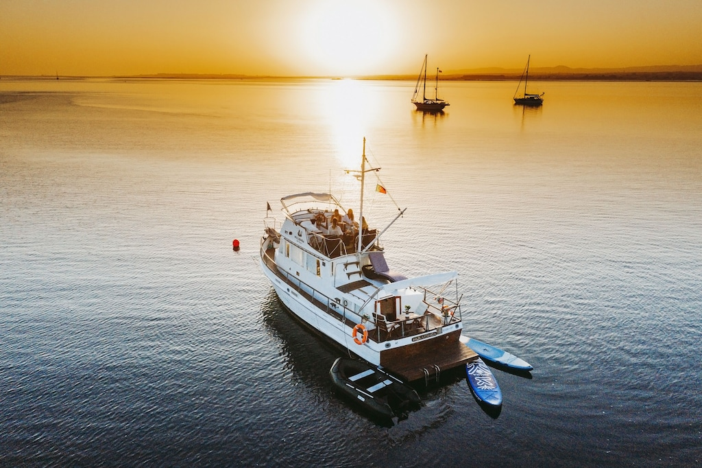 Houseboat Airbnb Algarve at sea during sunset