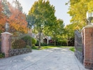 Grand entrance to 1 2/3 gated property with 2 homes.