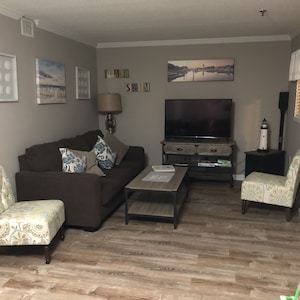 Living area with Smart TV and queen sleeper sofa