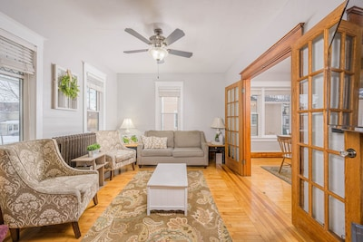 """Spacious living room with plenty of seating and a 55"""" smart TV"""