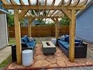 backyard w/ pergola and gas firepit