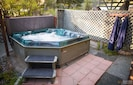 Stargaze in the private hot tub!