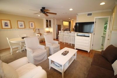 Spacious living area with flat screen tv