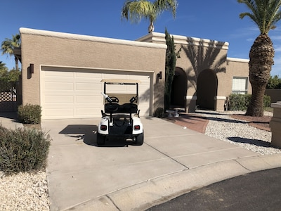 An easy ride to the clubhouse in your private golf cart!