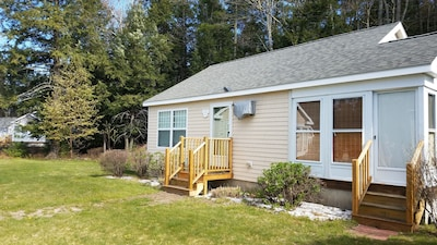Front of cottage ~ back up to woods ~ set back from parking lot