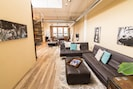 When you enter the penthouse loft, you'll find a cozy sitting area that doubles