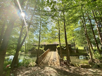Walkway over the pond to enter the cabin