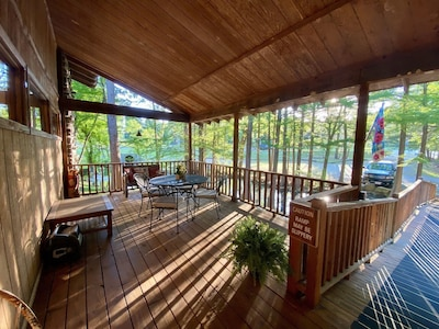 Huge double front porches overlooking the pond/creek.