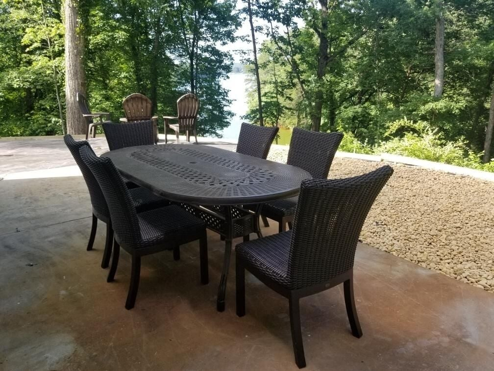 Outdoor table overlooking lake and fire pit