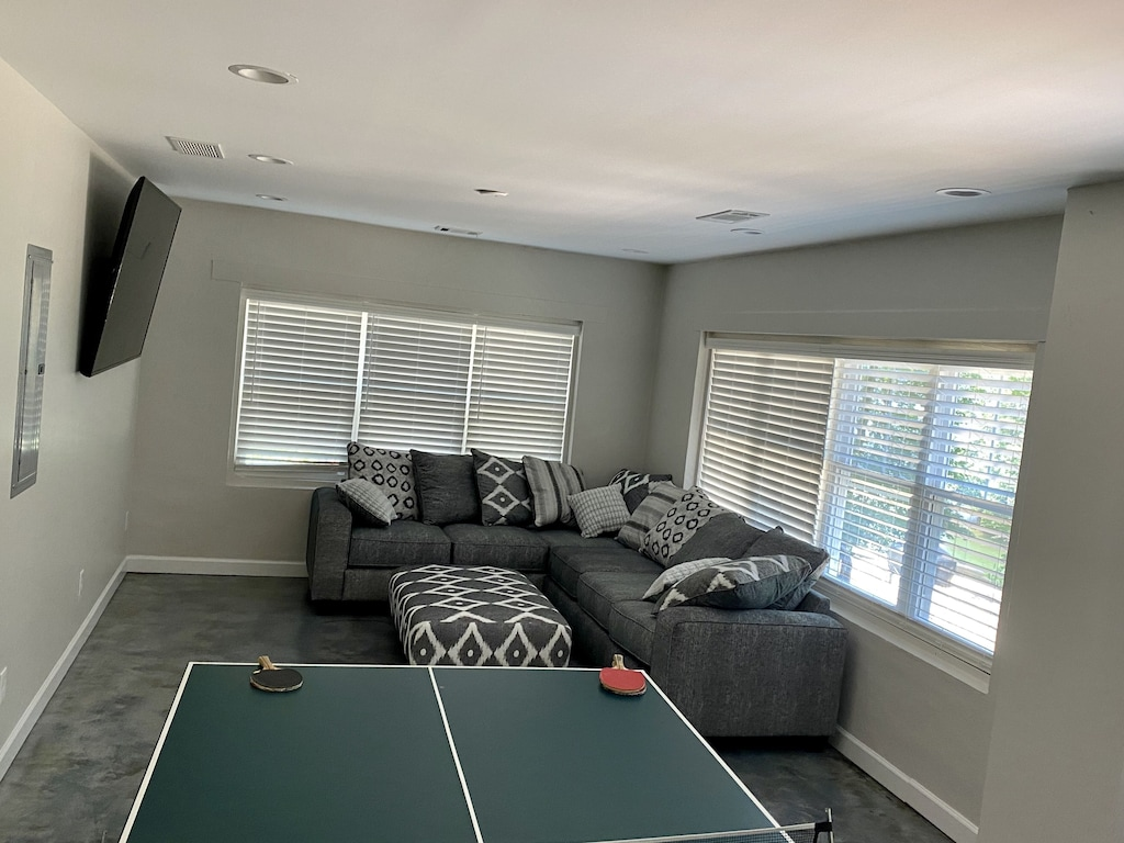 """Basement with 70"""" tv, sectional sofa and ping pong table"""