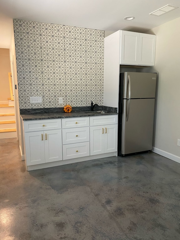 Wetbar and full refrigerator in basement