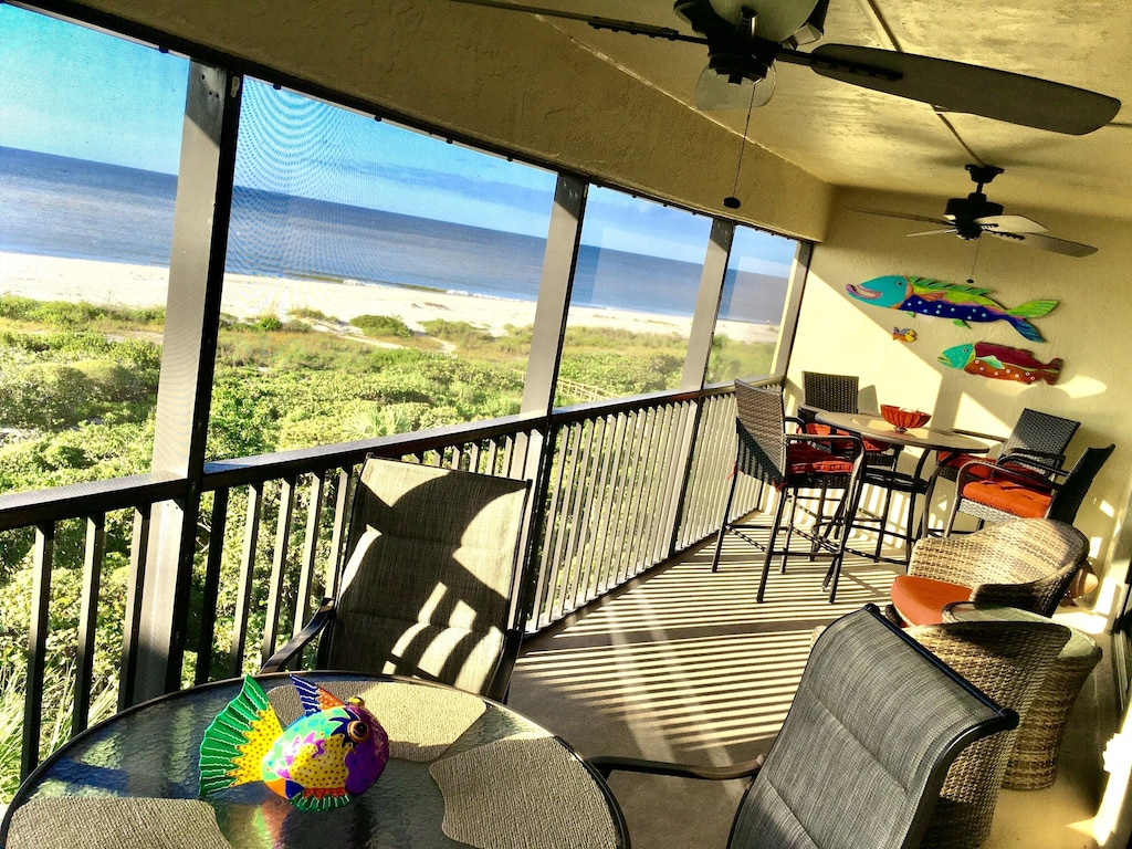 Enjoy your morning coffee on this beachfront lanai, oceanfront condo!