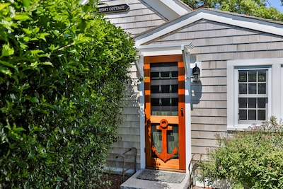 Charming cottage entryway exhibits a rich, maritime history welcoming its guests