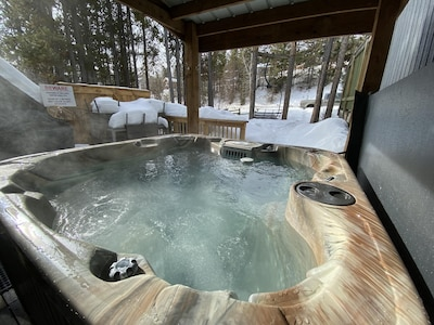 Private Hot Tub on the rear deck to relax in after a day in the mountains or on the golf course.