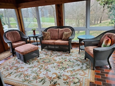 Wonderful sunroom to gather and plan your day.