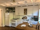 Completely renovated kitchen featuring quartz counter tops and new appliances.