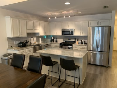 Kitchen with granite counter tops, stainless appliances, keurig  gas range!
