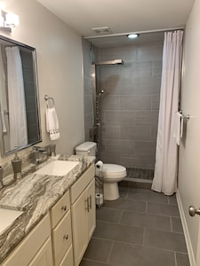 """Guest bath with tile shower, 59"""" dual rain waterfall shower panel, massage jets"""