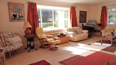 Ideal for relaxing in, the large living room benefits from sun for most of the day. It has several comfortable sofas and an additional sofa bed.