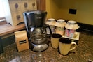 Fresh coffee, tea, sugar, creamer and sugar
