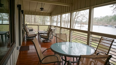 Screened porch to watch the herons