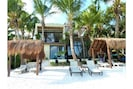 Brand new beachfront villa.  Swim & snorkel the coral reef with rays and turtles