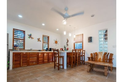 Lovely, bright kitchen and dining area.  Modern with mexican flare.