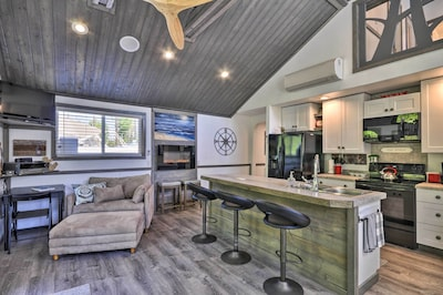 Vaulted ceilings and ample windows offer a bright, inviting interior.