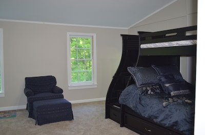 Kids room w/ twin over full bunk beds and twin trundle underneath.
