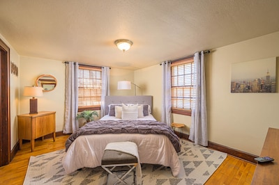 Master bedroom with new queen bed, smart TV and attached office.