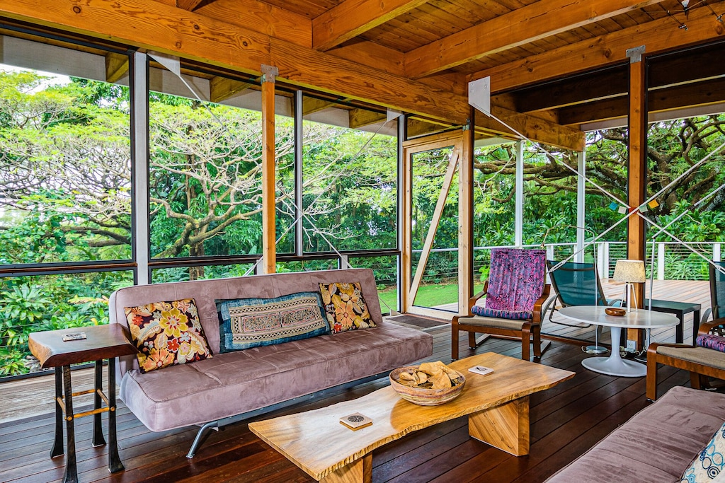 Lanai surrounded by tropical vegetation