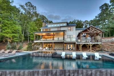 Lakeside Infinity pool and hot tub, covered party deck with fireplace