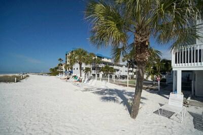 Royal Beach Club's white sandy beach at resorts edge