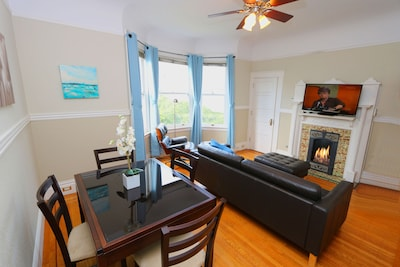 Great room with streaming flat screen tv and thermostat controlled gas fireplace
