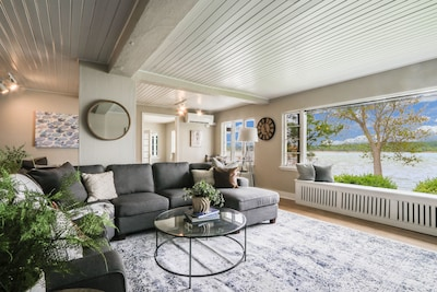 The living room provides plenty of room to gather and enjoy the views.
