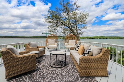 Spectacular lake views can be enjoyed inside and outside this home.