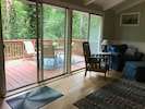 Three sliding glass doors connect the living to the deck.
