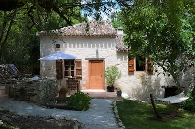 Front entrance to 'Petit Paradis', with its Quercy stone walls and patios.