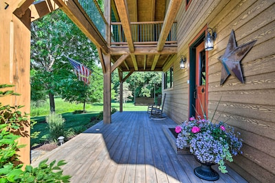 This farmhouse-style vacation rental includes a lovely porch for relaxation.