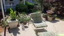 A place to enjoy some sun on the face; shared patio area.