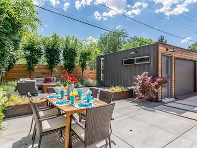 Nice back patio with private hot tub, dining table and fire pit
