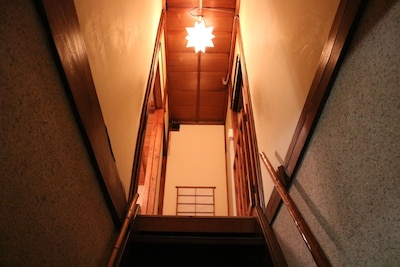 To upstairs/stairs to the second floor