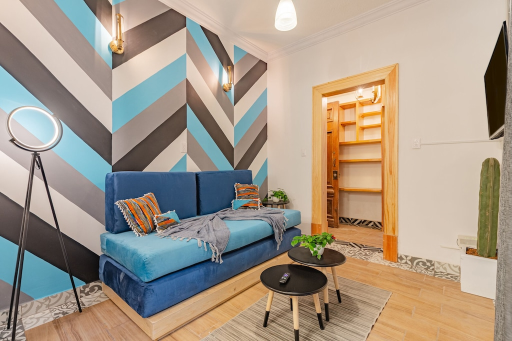 VRBO Mexico City: Blue stripes walls & blue sofa in a living room