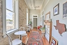 The bright hallway features 2 bistro tables ideal for sipping coffee!