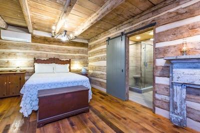 Bed and Barn door to bathroom