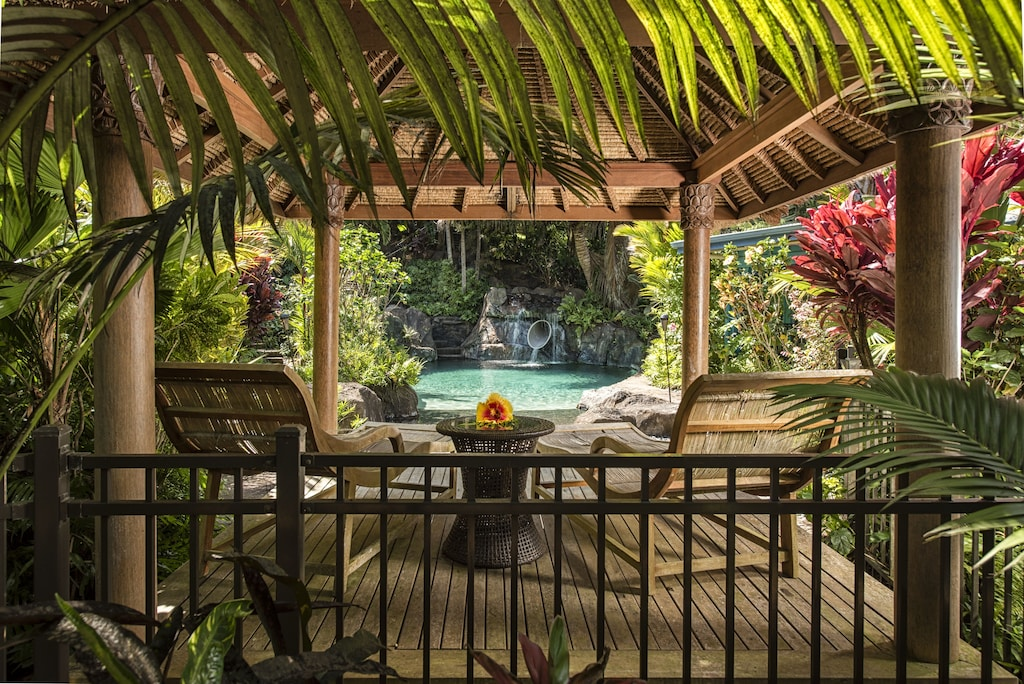 Gorgeous lanai with pool views in a tropical setting